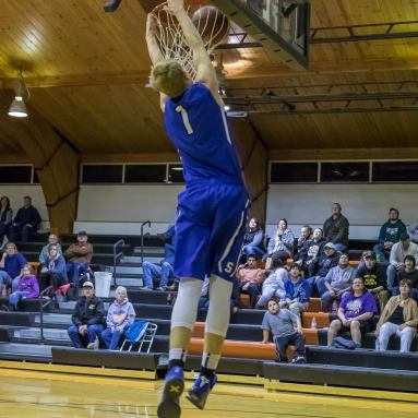 Stanley Blue Jay Wyatt Hanson goes up for a dunk.
