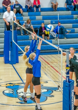 Daphne Enander and Kassie Meyer go up for a block (Photo credit: Alan Christianson)