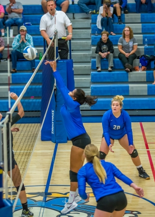 Kaitlynn Lindberg goes up for a block. (Photo Credit: Alan Christianson)