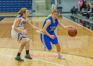 Stanley Blue Jay Sydney Larson drives past the Bottineau Stars defender