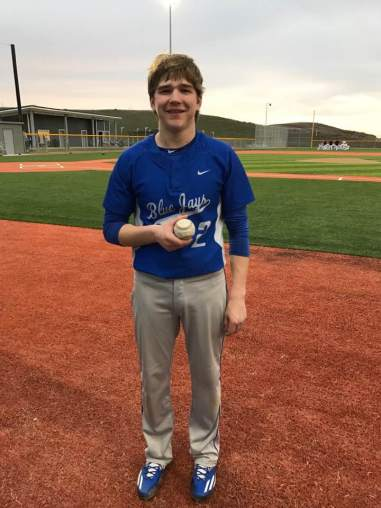Cody Ruden with Home Run ball (Photo by Donna Ruden)